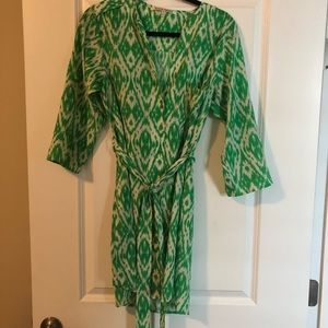 Green and white silky dress